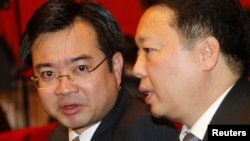 FILE - Nguyen Thanh Nghi, left, pictured with Vietnamese Vice Minister of National Resources and Environment Tran Hong Ha in 2011, has become one of the youngest provincial party chiefs in Vietnam at age 39.