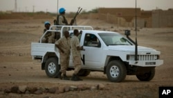 FILE - A vehicle with United Nations peacekeepers is seen in Kidal, Mali.