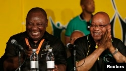FILE - South Africa's President Jacob Zuma, right, jokes with his deputy, Cyril Ramaphosa, after Zuma's re-election in 2012. A powerful union group has backed Ramaphosa to succeed President Jacob Zuma as head of the ruling party.