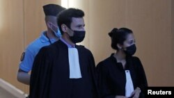 Olivia Ronen and Martin Vettes, lawyers of Salah Abdeslam, one of the accused, who is widely believed to be the only surviving member of the group suspected of carried out the attacks, arrive for the start of the trial of the Paris' November 2015 attacks