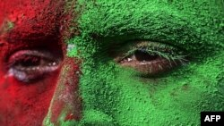 A Bangladeshi man, with his face painted in the colours of the national flag, takes part in a rally to mark the country's 44th Victory Day in Dhaka on December 16, 2015.