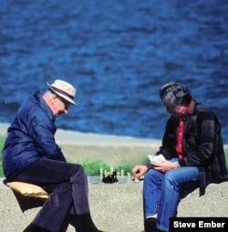 Two men enjoy the sunshine along Lake Michigan with a friendly game of chess. (Photo by Steve Ember)