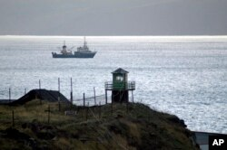 ** FILE ** Russian borderguards tower seen on Kunashir Island, one of the disputed Kuril Islands that are claimed by both Japan and Russia, in this November, 2005 file photo. A Russian patrol boat opened fire on a Japanese vessel in disputed waters Wednes