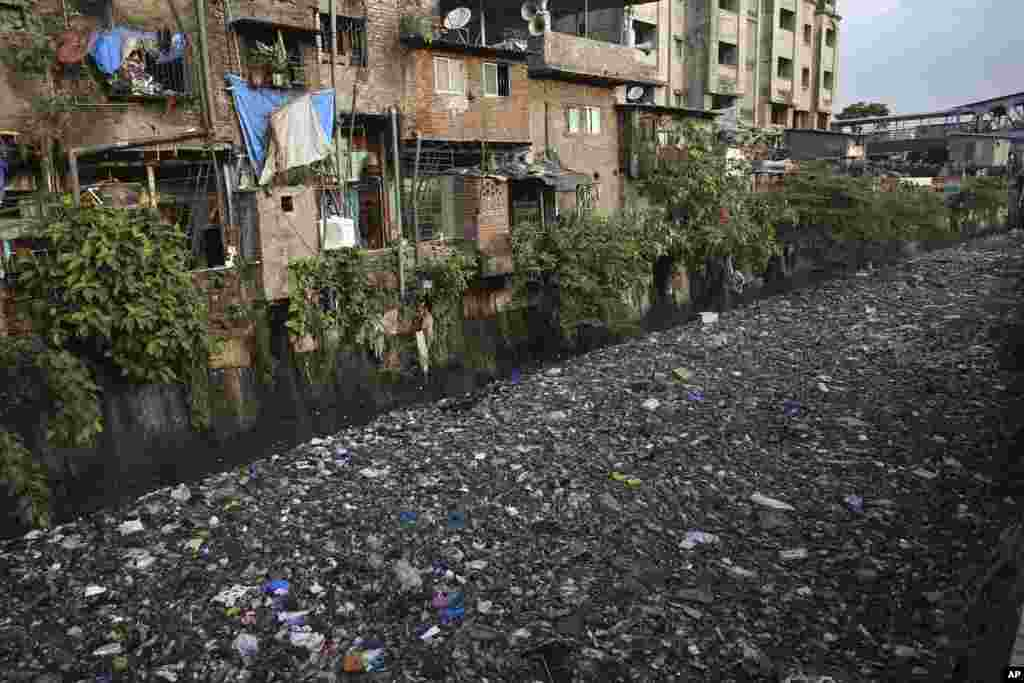 "Garbage fills up a polluted canal in Mumbai, India. The theme for this year's World Environment Day, marked on June 5, is ""Beat Plastic Pollution."""