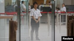 A demonstration of a security check for the Guangzhou-Shenzhen-Hong Kong Express Rail Link is performed at the West Kowloon Terminus, in Hong Kong, July 26, 2018.