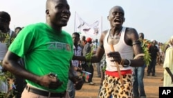 South Sudan men celebrate independence at a ceremony in Juba.