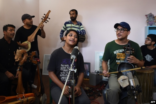 Nepali band Night gathers for a rehearsal during an interview with AFP in Kathmandu, Sept. 18, 2017.