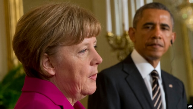 FILE - President Barack Obama and German Chancellor Angela Merkel participate in a joint news conference at the White House in Washington, Feb. 9, 2015. The two will confer on a variety of issues during Obama's two-day visit to Germany.