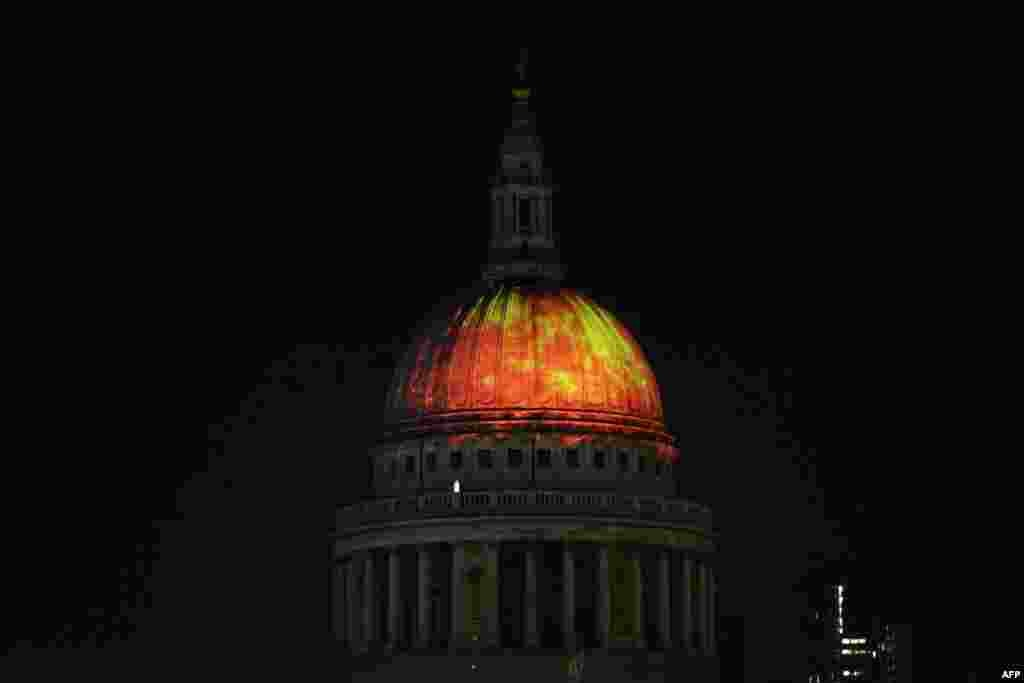 "The dome of St. Paul's Cathedral is lit up with a fiery projection during a rehearsal of artist Martin Firrell's ""Fires of London: Fires Ancient"" ahead of the London's Burning festival commemorating the 350th anniversary of the Great Fire of London."