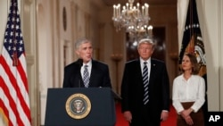 Judge Neil Gorsuch speaks as his wife Louise and President Donald Trump stand with him on stage in East Room of the White House in Washington, Tuesday, Jan. 31, 2017