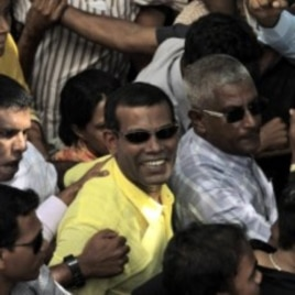 Mohamed Nasheed, center, who resigned Tuesday from his post as Maldivian president, marches along with his supporters during a rally in Male, Maldives, February 8, 2012.