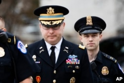 FILE - Army Lieutenant Colonel Alexander Vindman, a military officer at the National Security Council (C) arrives on Capitol Hill in Washington, Oct. 29, 2019, to testify as part of impeachment hearings.