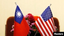 FILE - Flags of Taiwan and US in place for a meeting between US and Taiwan legislators in Taipei, Taiwan March 27, 2018.