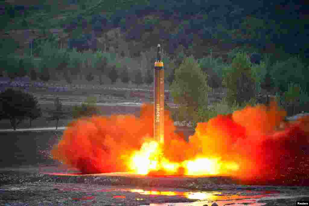 The long-range strategic ballistic rocket Hwasong-12 (Mars-12) is launched during a test in this undated photo released by North Korea's Korean Central News Agency (KCNA).