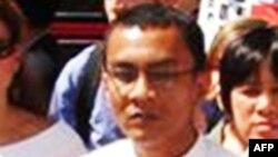 Một người Mỹ gốc Miến Điện ra tòa