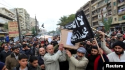 Lebanese Sunnis march through the northern city of Tripoli carrying coffins of Lebanese militants killed in Syria last December. Sunni militants from Lebanon have been fighting with Syrian rebels to oust Syria's Assad government.
