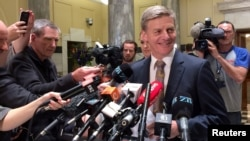FILE - New Zealand Finance Minister and Deputy Prime Minister Bill English speaks to members of the media in Wellington, New Zealand, Dec. 5, 2016.