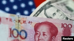FILE - U.S. Dollar and China Yuan notes are seen in this picture illustration.