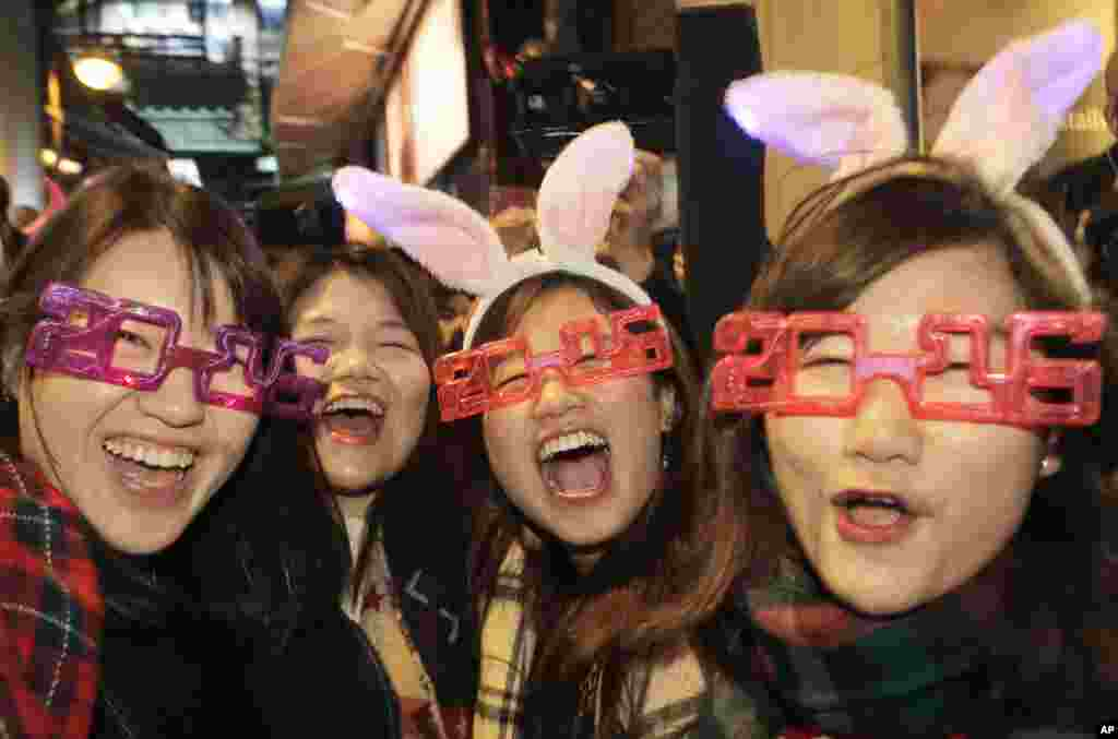 Revelers smile during the New Year's Eve celebrations in Hong Kong's Lan Kwai Fong.