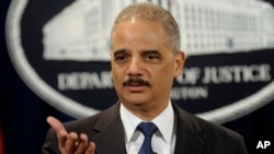 FILE - US Attorney General Eric Holder holds news conference at Justice Department in Washington.
