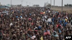 FILE - Captive Ethiopian soldiers walk towards the Mekele Rehabilitation Center in Mekele, the capital of Tigray region, Ethiopia, on July 2, 2021.