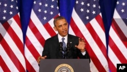 Presiden Obama berbicara tentang NSA, Jumat (17/1/2014) di Departemen Kehakiman, Washington DC. Presiden menghimbau dihentikannya kontrol pemerintah atas pengumpulan data panggilan telepon orang Amerika.