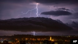 Lightning strikes over the sky in Nagykanizsa, Hungary, June 26, 2020. (Photo: Gyorgy Varga/MTI via AP)