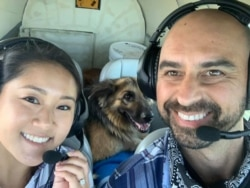 Pilot Eduard Seitan and his fiancee, Debbie, sit in the cockpit of his plane. They are preparing to deliver a rescue dog to its new home.