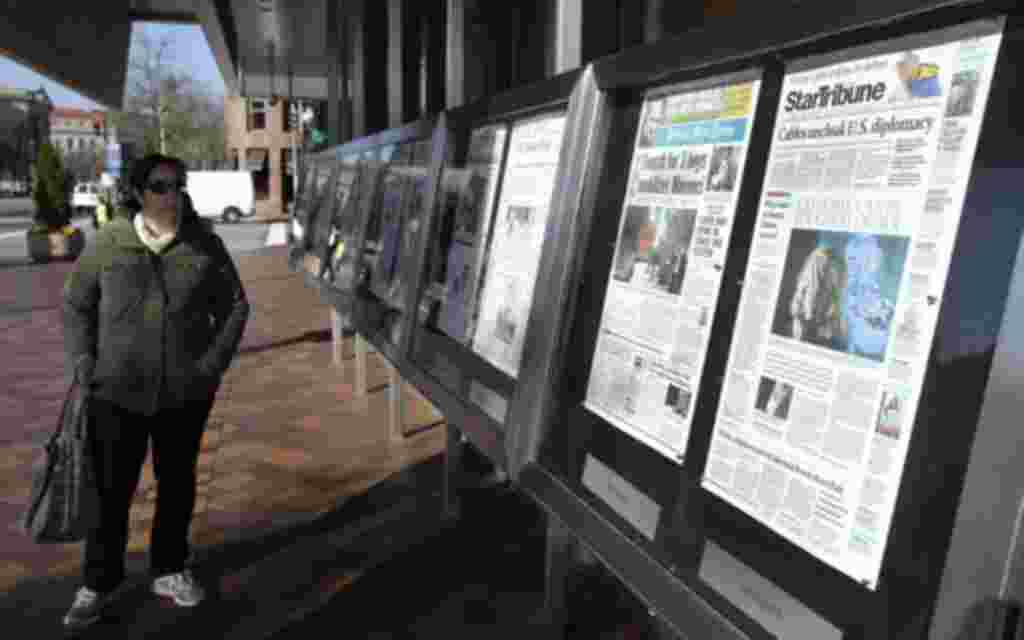 A woman reads Monday's U.S. newspapers front pages outside the Newseum in Washington November 29, 2010. Sunday's release of documents obtained by the whistleblower website WikiLeaks exposed the inner workings of U.S. diplomacy in recent years, including c