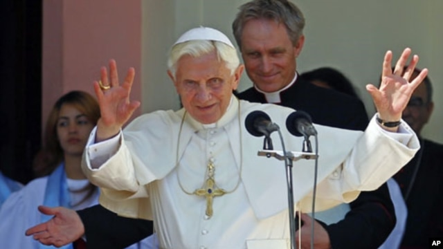 Pope Benedict XVI gestures to believers after visiting the sanctuary of the Virgin of Charity of El Cobre in El Cobre village, Cuba, March 27, 2012.