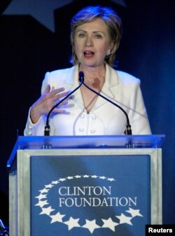 FILE - Then-Senator Hillary Clinton, wife of former U.S. President Bill Clinton, speaks at a fund raising gala for the Clinton Foundation in New York, Oct. 28, 2006.
