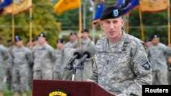 "FILE - U.S. Army Major General Gary Volesky speaks during a ceremony at Fort Campbell, Kentucky, Oct. 14, 2014. Volesky says Iraqi forces are making ""great progress"" in reclaiming land lost to Islamic State militants."