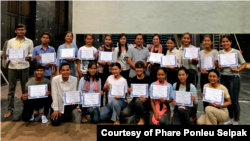 Srey Bandaul seen here with a group of art students after they finished a learning program with him. (Courtesy of Phare Ponleu Selapak)