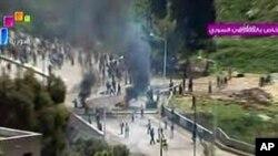 시리아 국영방송을 통해 방영된 다라의 시위장면