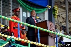 FILE - Hussein Ali Mwinyi makes an address after taking the oath of office in Zanzibar, Tanzania, Nov. 2, 2020.