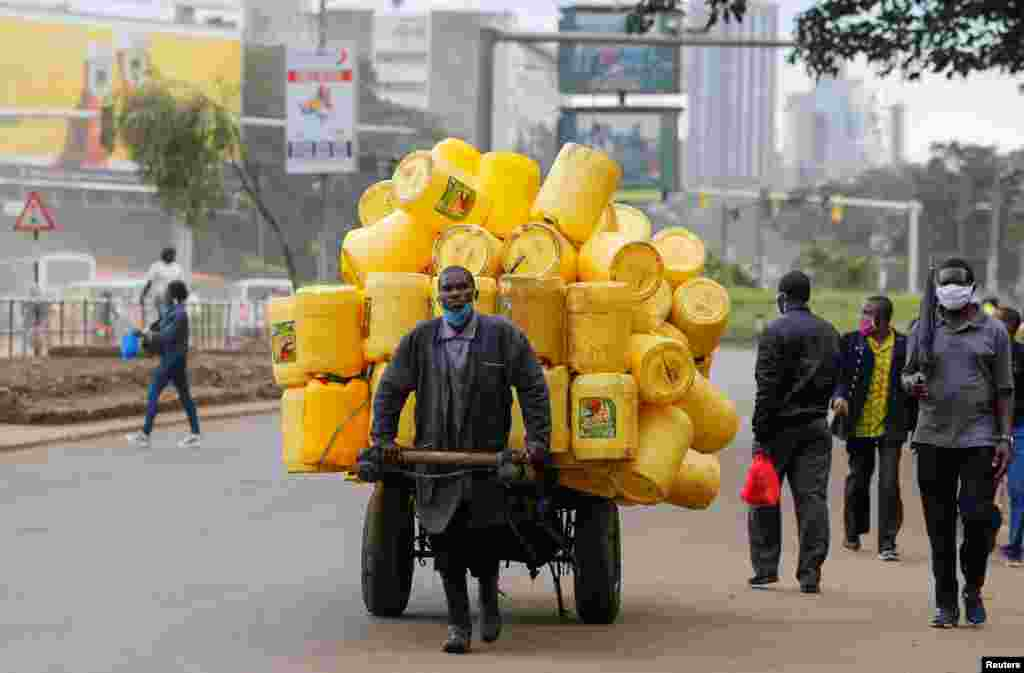 A man pulls a handcart with jerrycans in downtown Nairobi, Kenya.