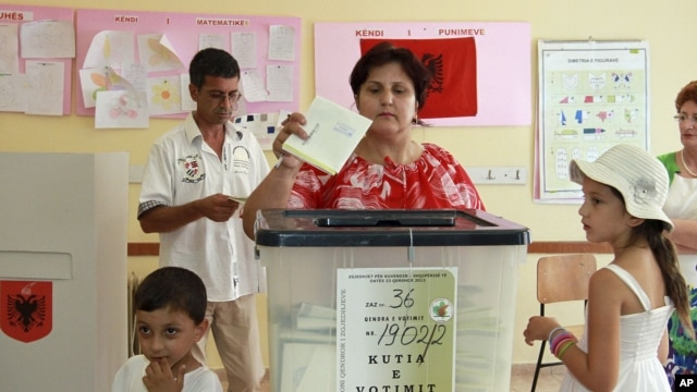 An Albanian voter casts her ballot in Tirana, Albania, June 23, 2013.