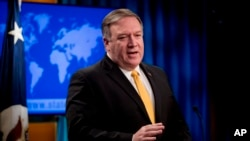 FILE - Secretary of State Mike Pompeo speaks at a news conference at the State Department in Washington.