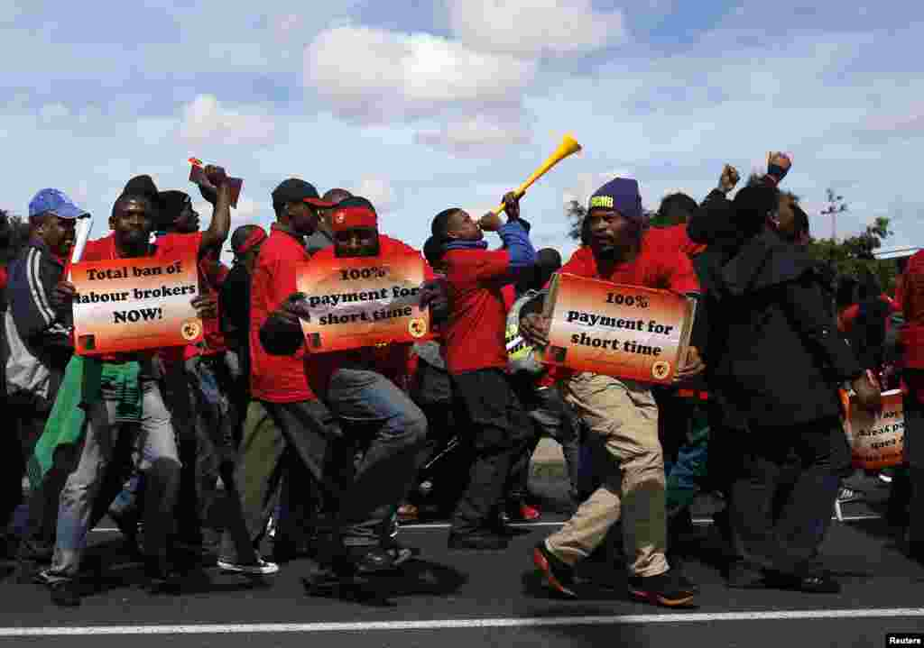 Members of the National Union of Metalworkers of South Africa (NUMSA) march during a strike in Cape Town, Sept. 9, 2013.