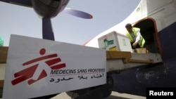 Workers unload emergency medical aid from Doctors Without Borders / Medecins Sans Frontieres at Yemen's Sana'a airport, April 13, 2015.