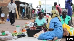Women are seen selling food stuff at a market in Mungula market, at a refugee settlement in Adjumani district, northern Uganda, June 15, 2017. (H. Athumani/VOA)