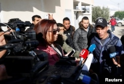 Walid, brother of suspect Anis Amri who was sought in connection with the truck attack on a Christmas market in Berlin, speaks to members of the media near their family home in Oueslatia, Tunisia, Dec. 22, 2016.