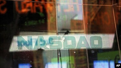 434b9dfb25a5 Electronic billboards reflected in the windows of NASDAQ in New York