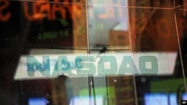 Electronic billboards reflected in the windows of NASDAQ in New York, Aug. 22, 2013.