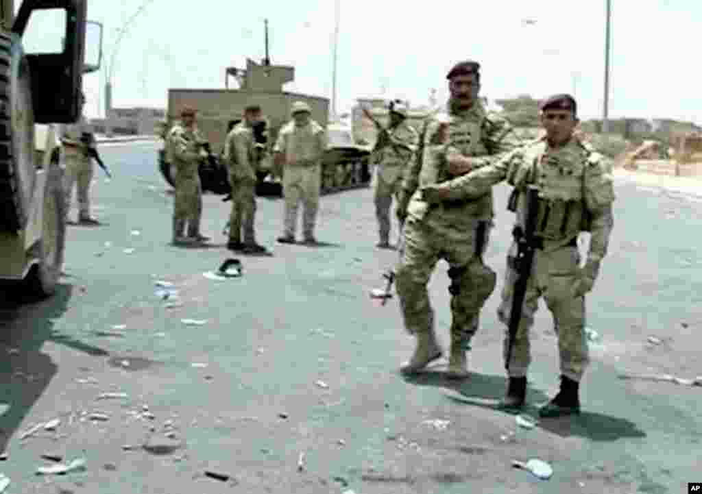 This image taken from video obtained from the Iraqi Military shows Iraqi soldiers during clashes with militants in the northern city of Mosul, Iraq, June 9, 2014.