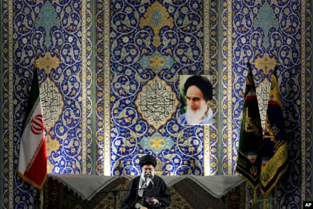 Iran's Supreme Leader Ayatollah Ali Khamenei delivers speech to paramilitary Basij force, saying pressure from economic sanctions will never force country into unwelcome concessions in nuclear negotiations, Imam Khomeini Grand Mosque, Tehran, Nov. 20, 201