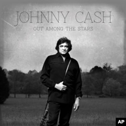 """This photo provided by Columbia/Legacy shows the Johnny Cash album cover for """"Out Among the Stars,"""" to be released March 25, 2014."""