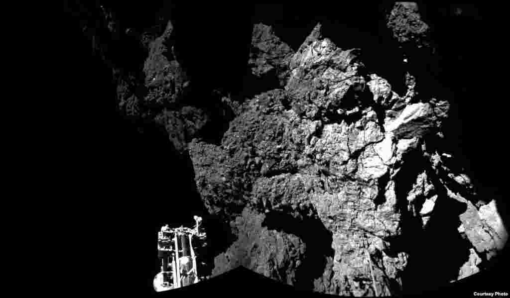 Rosetta's lander Philae is safely on the surface of Comet 67P/Churyumov-Gerasimenko, as these first two CIVA images confirm. One of the lander's three feet can be seen in the foreground. The image is a two-image mosaic, Nov. 13, 2014. (Courtesy: European Space Agency, photo released Nov. 13, 2014)