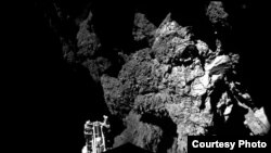 Lander Philae is safely on the surface of Comet 67P/Churyumov-Gerasimenko, as these first two CIVA images confirm. One of the lander's three feet can be seen in the foreground. The image is a two-image mosaic, Nov. 13, 2014. (ESA)