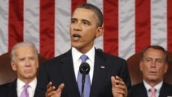 President Obama addressing both houses of Congress. Vice President Joe Biden, left, and House Speaker John Boehner are behind him.